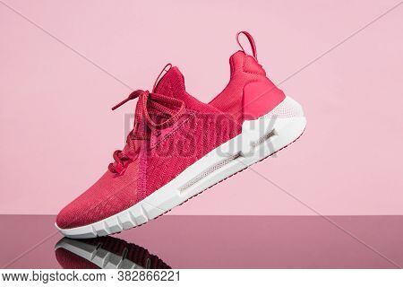 Running Sports Shoe On Pink Background. Running Shoe, Sneaker Or Trainer. Women's Athletic Shoe. Fit