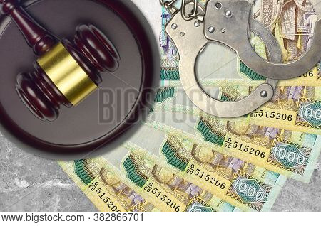 1000 Sri Lankan Rupees Bills And Judge Hammer With Police Handcuffs On Court Desk. Concept Of Judici