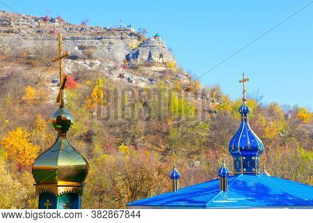 Orthodox Steeple Domes With Religious Cross . Pilgrimage In The Autumn