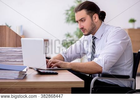 Young disabled employee suffering at workplace