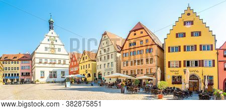 Rothenburg Ob Der Tauber,germany - August 09,2020 - Panoramic View At The Marktplace With Colored Ho