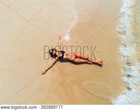 Woman on the Thai beach of Railay in Krabi Thailand