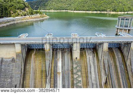 The View Of The Dam Of The Sau Reservoir, In The Ter River, In The Province Of Girona, Catalonia, Sp