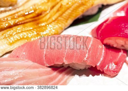Selective Focus Of Mix Sushi Sashimi On Dish In The Restaurant (japanese Food)
