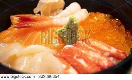 Selective Focus Of Mix Sashimi (salmon, Crab, Shrimp, Scallop) In Rice Bowl, Mix Sushi Donburi In Th