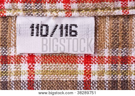 real macro of clothing label size 110/116 poster