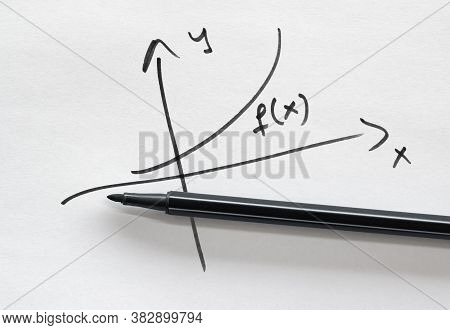 Hand Drawn Graph Of An Arbitrarily Chosen Function And A Felt Pen