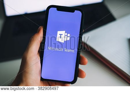 Hand Holding Iphone With Microsoft Teams Video Call App Logo On The Screen. High Quality Photo