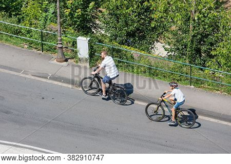 Luxembourg City, Luxembourg - August 18, 2018: Aerial View Two Cyclists In Luxembourg City