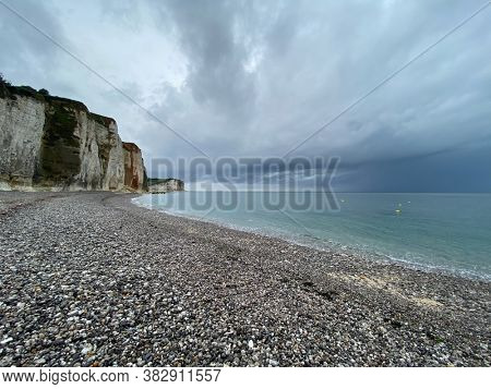 Pebbles beach and limestone cliff at Veulettes-sur-Mer, Normandy, France