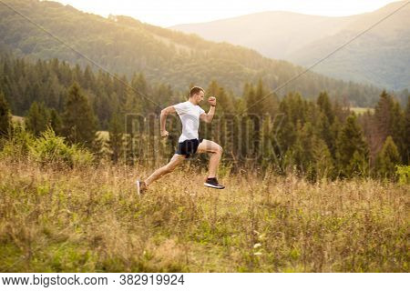 Running Fitness Man Sprinting Outdoors With Beautiful Mountains Landscape On Background. Runner Trai