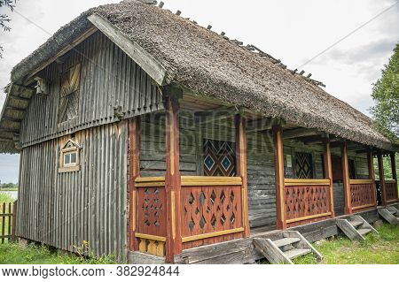 Riga, Latvia - July 29, 2019: Old Wooden House In The Riga Open-air Museum Which Represents Architec