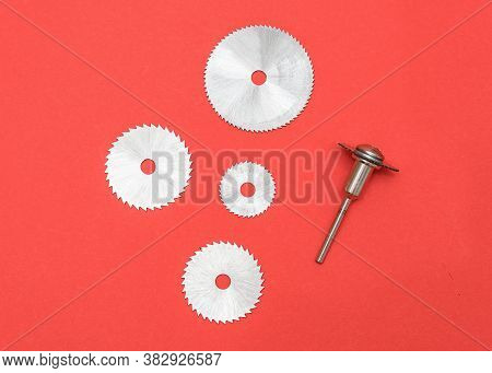 Cutting Blades For Professional Engraving Machine Isolated On Red Color. Dremel Attachments