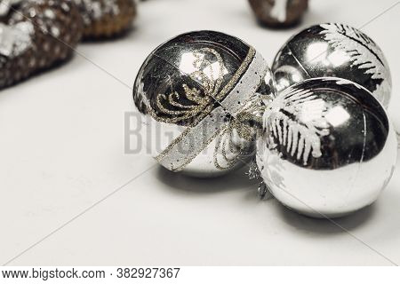 Close-up Shot Of Silver Christmas Tree Decorations. Christmas Decoration Stock Photo. Holiday Decora