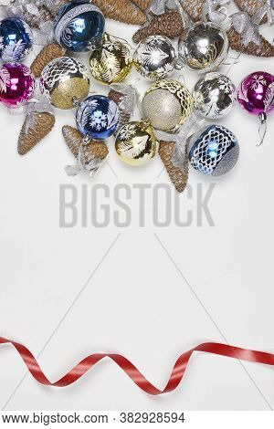 Top View Of Xmas Tree Decorations And Pine Cones. Vertical Stock Photo Of Decorative Christmas Ornam