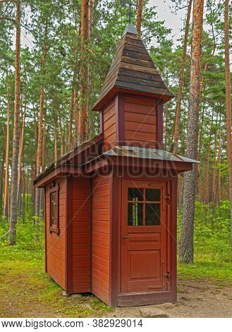 Riga, Latvia - July 29, 2019: Old Wooden Chapel In The Riga Open-air Ethnographic Museum.