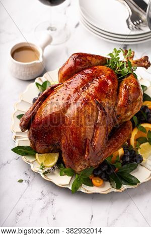 Thanksgiving Or Christmas Roasted Turkey Served With Gravy
