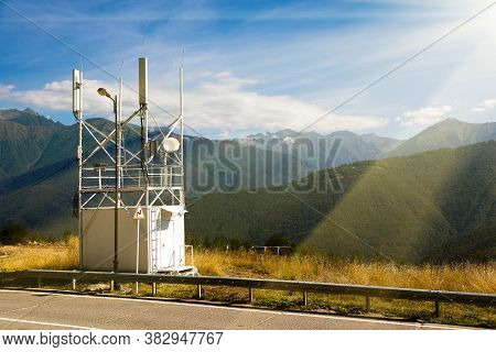 Telecommunications Transmitters 4g, 5g. Cellular Base Station With Transmitter Antennas Near A Road