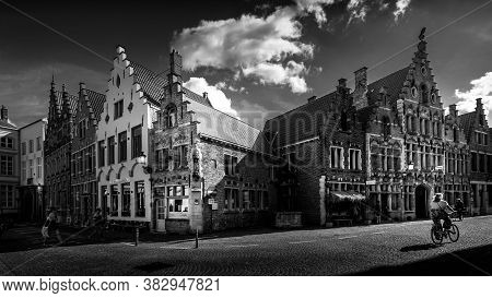 Brugge / Belgium - Sept. 18, 2018: Black And White Photo Of Medieval Houses With Step Gables Along T
