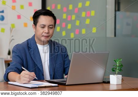 Business Man Working And Note Job In Paper In Office.
