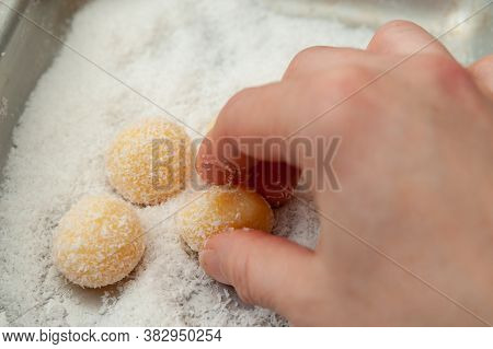 Hand Making Beijinho De Coco, A Traditional Brazilian Candy Called Coconuts Little Kiss. Top View. H