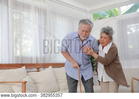 Middle Aged Asia Man Feeling Pain Ache Touching Chest Having Heart Attack, Sad Worried Senior Older