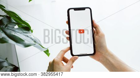 Bangkok, Thailand - August 30, 2020 : Woman Hand Is Pressing The Screen Displays The Youtube App Ico