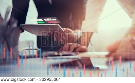 Stock Exchange Market Concept, Businessman Trader And Team Looking On Tablet With Graphs Analysis Ca