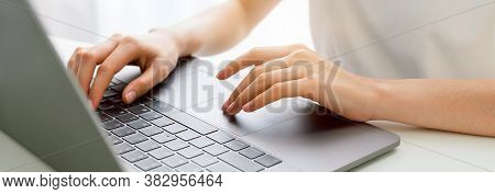 Hand Using Laptop Computer With The Press Keyboard At Office. Proportion Of The Banner For Ads.