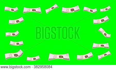 1000 Baht Thai Money Flying Isolated On Green Screen Background, Banknote Money Falling Over Green C
