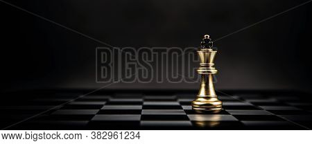 King Golden Chess Standing On Chess Board Concept Of Business Strategic Plan And Professional Organi