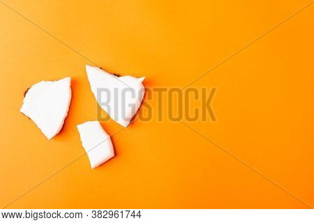 Happy Coconuts Day Concept, Fresh Coconut Group Pieces Slices, Studio Shot Isolated On Orange Backgr