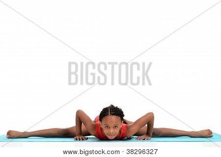young girl doing gymnastics front split