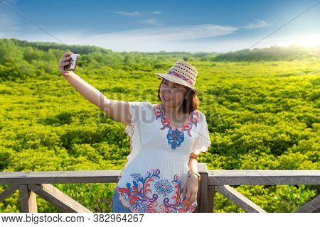 Asian Women Take A Photo Of Mangrove Forest Ecotourism Thung Prong Thong, Rayong Province, Thailand