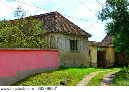 Typical Rural Landscape And Peasant Houses In  The Village Cata, Transylvania, Romania. The Settleme