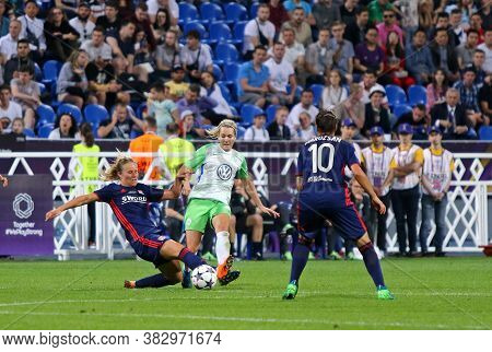 Kyiv, Ukraine - May 24, 2018: Camille Abily Of Olympique Lyonnais (l) Fights For A Ball With Lena Go