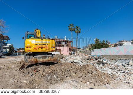 Antalya / Turkey - January 19, 2020: Hidromek Hmk 140w Excavator Stands On A Demolished Building In