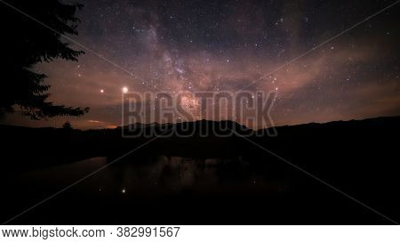 A Starry Night With Thee Milky Way Partly Reflecting In A Little Pond At The So Called Winklmoosalm