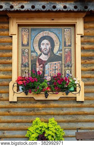 A Large Church Icon Of Jesus Christ Against A Wooden Wall In A Beautiful Frame.