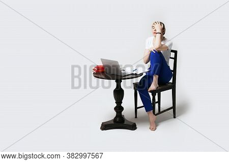 Stressed Young Female Student Sitting At Desk Working Or Studying Remotely Online Makes A Facepalm G