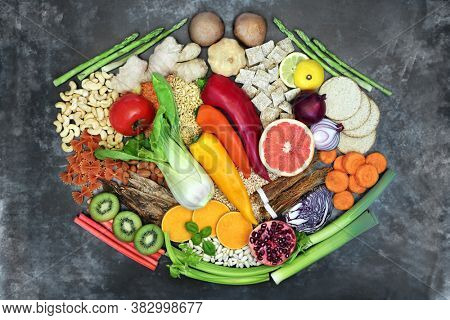 Super food for good health with foods high in antioxidants, anthocyanins, vitamins, minerals, protein, omega 3 and fibre. Flat lay on grunge background.