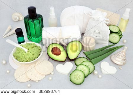Anti aging natural skin care beauty treatment with aloe vera, cucumber and avocado with face mask, essential oil, moisturizer & cleansing products with decorative seashells & pearls.