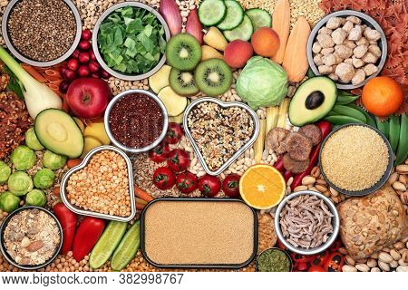 Vegan food for a healthy heart concept with foods high in protein, omega 3, vitamins, minerals, anthocyanins, antioxidants, smart carbs and dietary fibre. Ethical eating. Flat lay.
