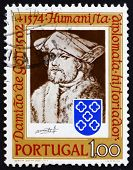 a stamp printed in the Portugal shows Damiao de Gois, by Durer, Humanist, Writer, Composer, 400th Anniversary of the Death, circa 1974 poster
