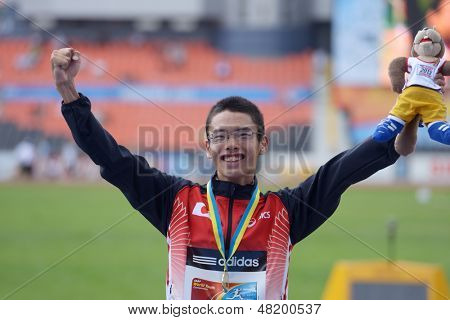 DONETSK, UKRAINE - JULY 13: Toshikazu Yamanishi of Japan win gold medal in 10,000 m race walk during 8th IAAF World Youth Championships in Donetsk, Ukraine on July 13, 2013