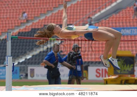 DONETSK, UKRAINE - JULY 12: Emma Stenlof of Sweden competes in high jump competition in Heptathlon during 8th IAAF World Youth Championships in Donetsk, Ukraine on July 12, 2013