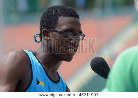 DONETSK, UKRAINE - JULY 12: Janeko Cartwright of Bahamas win the heat on 200 metres during 8th IAAF World Youth Championships in Donetsk, Ukraine on July 12, 2013