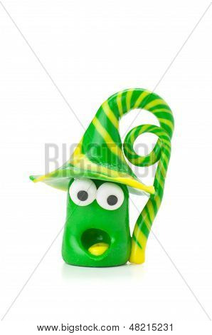 Handmade modeling clay figure with green and yellow stripes