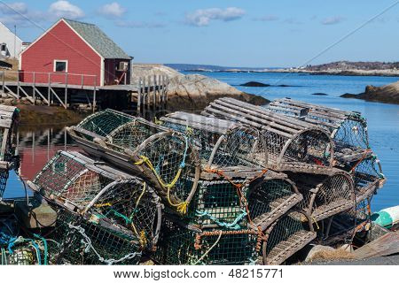 Lobster traps piled up on a wharf in Peggy's Cove, Nova Scotia, Canada.