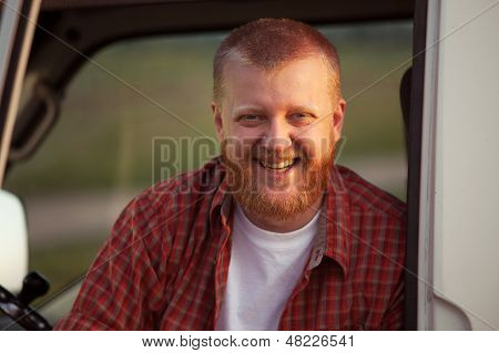 Cheerful red-bearded man in a red plaid shirt poster